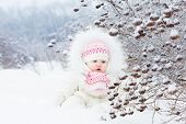 Beautiful Baby Girl Playing In The Snow