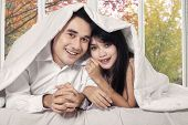 Couple Covered Blanket In Bedroom