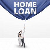 Couple Pulling A Home Loan Banner