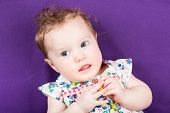 Sweet Baby Girl In A Summer Dress On Purple Background