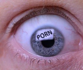 image of pornography  - Concept of Porn addiction an eye looking at a screen of pornography - JPG