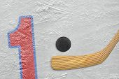 Hockey Stick, Puck And The Numeral One
