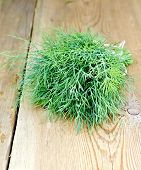 Dill on wooden board