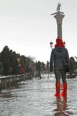 People Walking on the catwalk In Venice During At High Tide