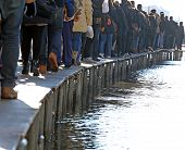 People Walking on the catwalk In Venice Italy During At High Tide