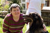 foto of caress  - mentally disabled woman is caress a dog - JPG