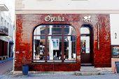 Vilnius City Town Old Street With Optika Shop