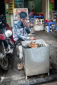 Vietnamese Man Cooking On The Street