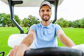 Driving A Golf Cart.
