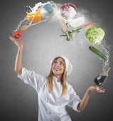 image of juggler  - Juggler chef plays with some ingredients and kitchen tools - JPG