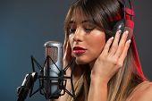 Woman Singer Recording A Ballad