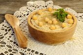 Hummus In A Wooden Bowl