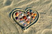 image of beach shell art  - Heart made of sea shells on the beach - JPG