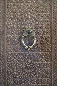 Vintage bronze door and door handle in Agha Bozorg mosque, Kashan, Iran.