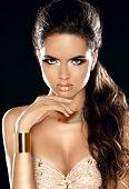 Fashion Beauty Girl Portrait. Golden Jewelry. Gorgeous Woman Portrait. Stylish Haircut And Makeup. H