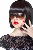 Makeup And Manicured Polish Nails. Fashion Brunette Woman Wearing In Sunglasses Isolated On White Ba