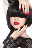 Fashion Model. Long Black Fringe. Red Sexy Lips. Bob Hairstyle. Polish Manicured Nails. Haircut. Tre