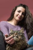 Young Woman Cuddling A Cat