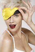 Beautiful Smiling Model Wearing A Yellow Sleep Mask
