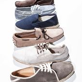 Set of man footwear on a white background