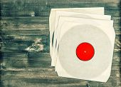 stock photo of nostalgic  - vintage vinyl records on rustic wooden background - JPG