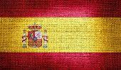 Spain flag on burlap fabric