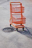 Orange trolley in a parking lot