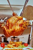 foto of spit-roast  - Chicken with vegetables on a spit ready - JPG