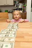 Little Cute Girl With A Lots Of Dollar Bills