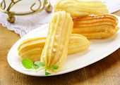 pic of eclairs  - choux pastry dough eclairs with vanilla cream - JPG