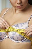 pic of measurements  - Woman Measuring Her Bra Size With Tape Measure - JPG