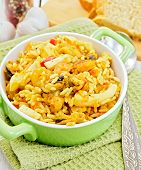 Pilaf with seafood and bread on napkin
