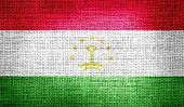 Tajikistan flag on burlap fabric