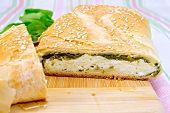 Roll filled with spinach and cheese on cloth