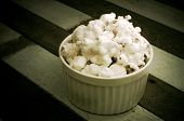 Popcorn in a white ceramic bowl Soft focus and filter image