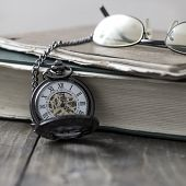 An Antique Pocket Watch, Glasses And Bible