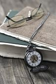 An Antique Pocket Watch, Glasses And Book