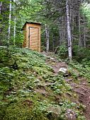 picture of outhouses  - A stylish outhouse tucked neatly away on a hill - JPG