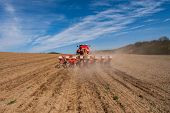 foto of plowing  - Sowing and plowing action in the spring season