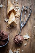 stock photo of chocolate spoon  - Chocolate ice cream on wooden background - JPG