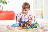 foto of indoor games  - kid girl plays with educational toy indoors - JPG