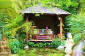 picture of gazebo  - Comfortable seating in a gazebo at a pond taken in a mediation garden - JPG