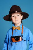 picture of 7-year-old  - Portrait of a cute 7 year old boy in elegant hat and bow - JPG