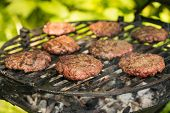 picture of beef-burger  - Beef burgers cooking on grill plate - JPG