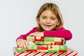 pic of missing teeth  - A little girl in a studio environment with presents missing her two front teeth - JPG