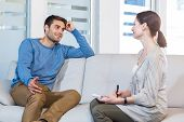 pic of psychologist  - Psychologist talking with happy man in the office - JPG