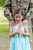 pic of reunited  - Soldier reunited with his daughter on a sunny day - JPG
