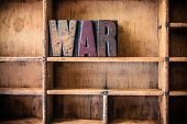 pic of cold-war  - The word WAR written in vintage wooden letterpress type in a wooden type drawer - JPG