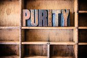 image of purity  - The word PURITY written in vintage wooden letterpress type in a wooden type drawer - JPG