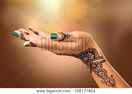 Woman Hand with black mehndi tattoo. Hand of Indian bride girl with black henna tattoos. Showing emp
